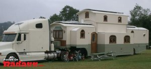 Yes, this is a camper shaped like a house. Not sure about the architectural style here.