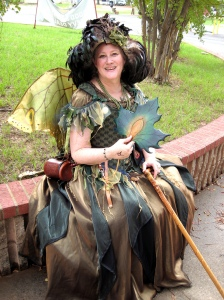 She even has a green dress and is holding a leaf that seems to be changing color. Guess fall must be around the corner.