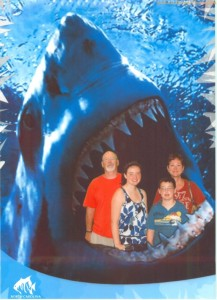 Relax, they were at an aquarium in North Carolina and got their picture there. Interesting, they chose a shark backdrop for it.