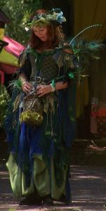 Love how she has her green and blue costume coordinate with the peacock feathers she uses as wings. Very ingenious of her.