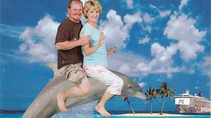 And what better way to show it than by being photoshopped riding on a dolphin? Yeah, it's pretty obvious.