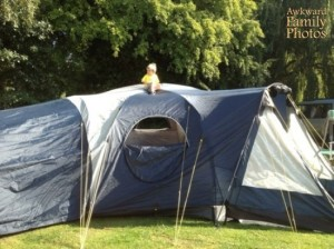 In reality, the kid was on the tent, not in the tent. Still, someone get him off there.