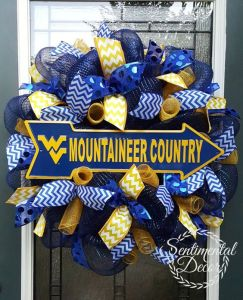 Yes, this is a WVU ribbon wreath. But I think the arrow really makes it work here.