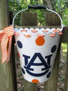 This is decorated in orange and navy blue polka dots. And it's lined with a striped orange ribbon.