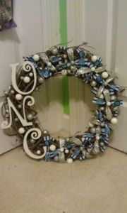 This one has white and silver berries as well as shiny ribbon. And the UNC letters are in a whimsical font.