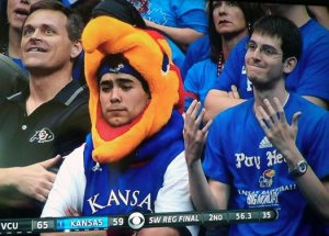 Okay, so his team lost. Big deal. But I do like how he's wearing a Jayhawk outfit though.