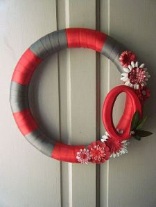This Ohio State ribbon wreath does exactly that. Just the logo and flowers. That's it.