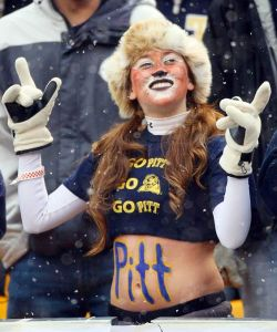 Yeah, I know bare midriffs aren't a great idea in snowy weather. But I do like her Panther hat and makeup though.