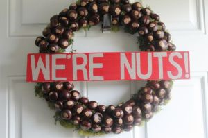 This is decorated with buckeye nuts and moss. Very fitting with the Ohio State spirit and very creative.