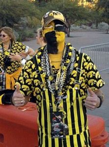 Well, it's a hawk suit and striped coveralls. And it's tacky as can be. But at least he's in the Iowa spirit of things.