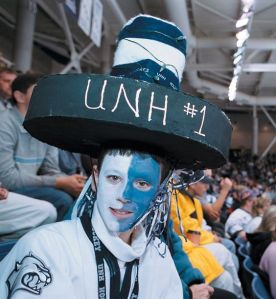 Doesn't hurt that he's wearing a puck hat to boot. Also he painted his face white and light blue.