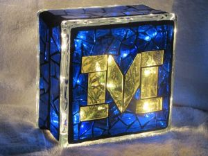 This stained glass block is surely a gem. Like how the light shines through the blue and gold.