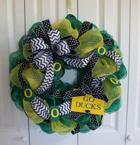 This one has the Oregon University colors as well as a ribbon. Love the decorations on this.