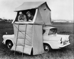 I didn't know they had tents like that in the 1950s. Guess this couple really wanted to save space at their campsite. Or maybe they just wanted the view.