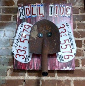 This was made from old license plates and a shovel. I think it looks better than Alabama's real mascot.