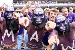 Yes, they may be wearing purple skull heads. But they're probably as harmless as can be. They're just supporting their Wildcats at the game.