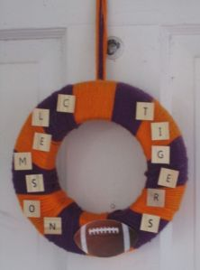 I think this person used letter tiles for this. Gives the wreath its whimsical charm.