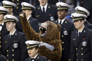 Luckily for them, it's a guy in a bear costume. But I love how he seems to be cheering on in the stands.