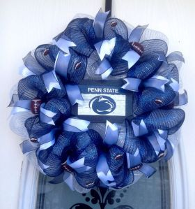 It's deco mesh with ribbons. But it also has a wooden Penn State panel in the center where it counts.