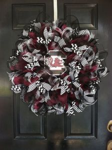 If it wasn't for the darker red and the logo, I would've thought it was a Crimson Tide wreath. And yes, their team is called the Gamecocks. I did not make that up.