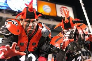 Well, they have red and black shoulder pads along with crazy hats. But they'll do for this fan post. Also, Cinci's mascot is a bearcat which isn't a fierce creature by any stretch.