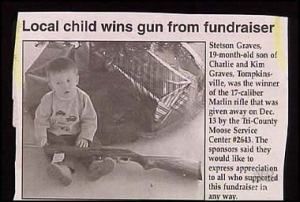 At first, I thought the firearm in question might be a BB gun. Turns out it's a real gun which just begs the question: How in the hell did a baby manage to win this? I mean this very picture pretty much sums up why I staunchly support gun control.