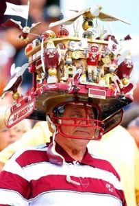 Now that hat is just so unreal. Just looks like a small carousel. Someone must have too much time on his hands.