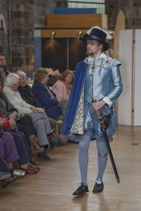 Because such outfits in the 16th century were a man's way of showing how rich they were. Like the cape and hat.