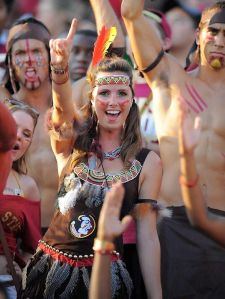 Yes, she loves the Florida State Seminoles so much that she's willing to practice cultural appropriation to show her team spirit. Yes, Native Americans, I give you permission to facepalm at this time. Yes, it's very offensive and something you shouldn't do at a football game.