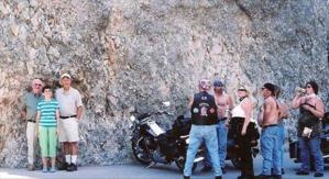 Yes, there's a biker gang nearby. No, I don't know if they're just there to admire the scenery. But it's pretty funny.
