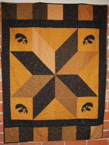 Unlike some of the quilts I've seen, this one has a nice patchwork design. Like the Hawkeyes in the corners.