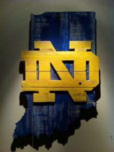 Of course, Notre Dame is perhaps the most interesting thing to come out of Indiana. But the gold logo looks really cool in the blue background.