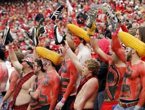 Nebraska's team is the Huskers. And yes, some of them wear corn heads which I think is ridiculous. But the shoe thing speaks for itself.