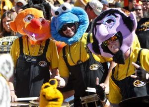 These are members of the Missouri band dressed up as Sesame Street characters in the stands. Yes, they seem to be having a good time.