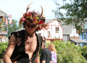 Sure he looks like a faun or satyr. But the guy is wearing antlers. So it may be hard to say at any length.