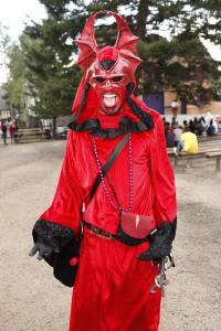 Or just have people dressed up as demons in their own incarnation. This one is mostly dressed in red with fur trimming on his outfit.