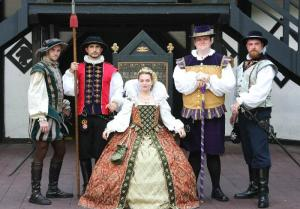 Guess this is the court of Queen Elizabeth I. And probably before the Armada as well. Or she's wearing a scaled down outfit.