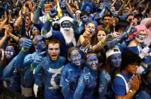This is a scene from Duke where the fans paint themselves with blue body paint. I know it's ridiculous but it's a tradition.