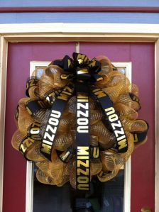 This is a gold wreath with a black Mizzou ribbon. Very well done, according to some fans.