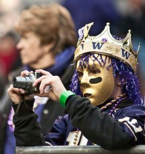 Guess someone wants a good view of the Huskies. Even in a crown and gold mask which seems more suitable for Mardi Gras than anything.