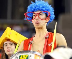Even if he's wearing big red glasses and a blue clown wig. And did I say he's a drummer?