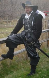 Well, he seems to be a strapping man with a rapier and boots. Like his hat.