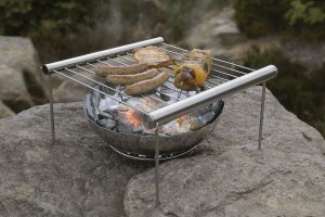 Comes with a tray and fire pit. But it sure looks quite simple to assemble. Doesn't it?