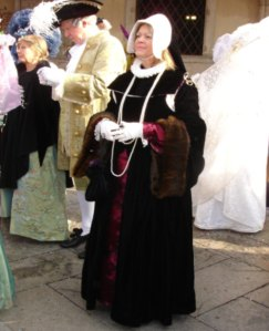 As far as this woman is concerned, such costume would denote how rich she was. At the Renaissance Faire, it just looks cool.