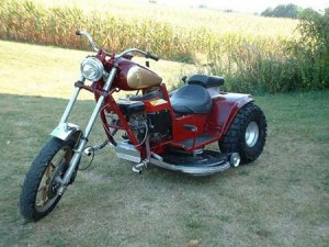 Yes, this is a motorcycle riding mower. It's part motorcycle, part tractor. Probably some kind of project in some guy's garage.