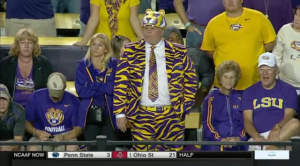 Yes, the outfit looks totally hideous and not something you'd want to wear on the street. But this guy is supporting his team. Don't judge him.