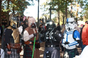 Or these people are on their way to a Star Wars convention afterwards. Is that Stormtrooper dressed like a Scottish guy from Braveheart?