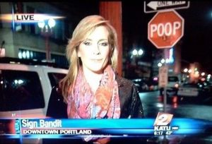 And it seems that the sign bandit was just there. Just look behind the reporter.