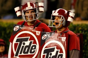 So they have toilet paper rolls on their helmets and are wearing large red Tide boxes. Love it.