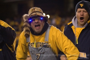 Well, he's dressed like a Mountaineer with a raccoon tail and coveralls. He also has light up glasses, too.